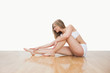 Young  woman in yoga pose on hardwood floor