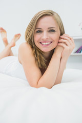 Close-up portrait of beautiful relaxed woman in bed