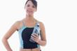 Portrait of young woman in sportswear holding water bottle