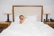 Brunette woman sleeping in bed