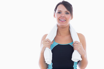 Portrait of woman in sportswear holding towel around neck
