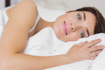 Female smiling in bed