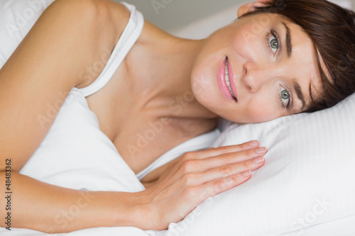 Beautiful woman smiling in bed