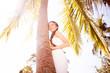 woman near palm tree