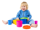 Cute baby boy plays with buckets