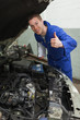 Confident mechanic gesturing thumbs up