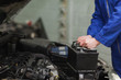 Mechanic changing car battery - 48483786