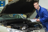 Mechanic analyzing car engine