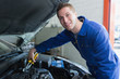 Male mechanic fixing car engine