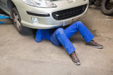 Mechanic under car