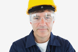 Technician wearing protective glasses and hardhard