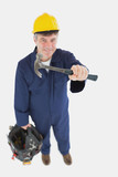 Mechanic with hammer carrying tool bag