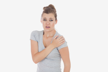 Portrait of woman suffering from shoulder pain