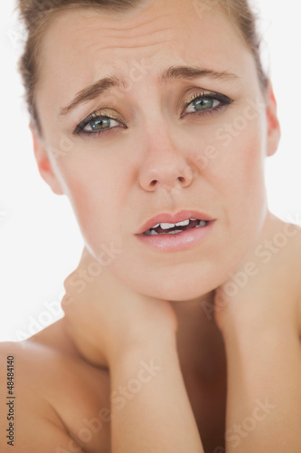 Woman suffering from neckache