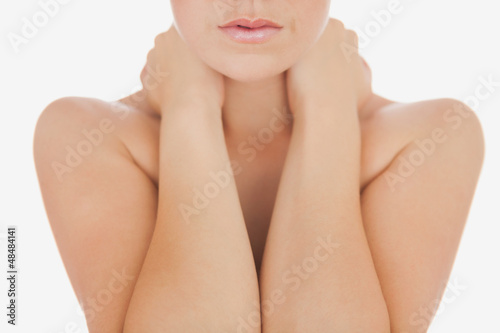 Woman massaging neck over white