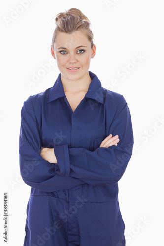 Female technician with arms crossed