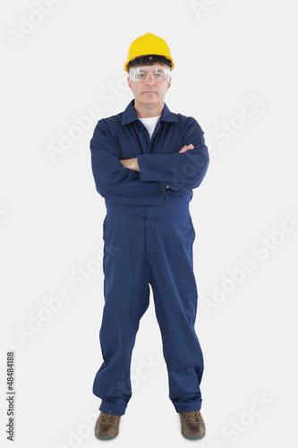 Confident technician wearing hardhat and eyewear
