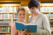 Couple standing looking at a book