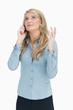 Woman explaining on the telephone