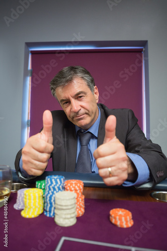 Man giving thumbs up at roulette table