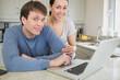 Cute couple using laptop