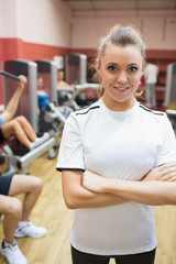 Female trainer in weights room