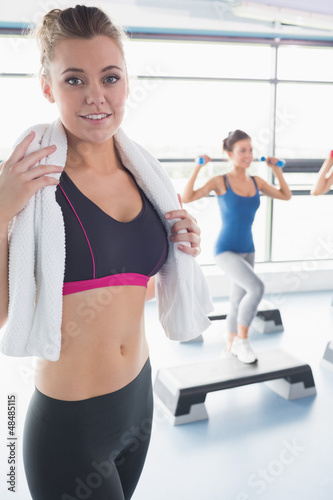 Woman with towel around her neck at aerobics class
