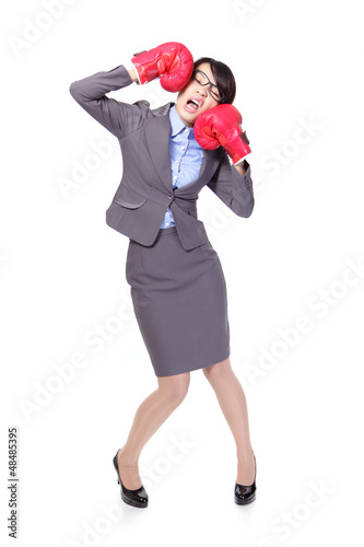 business woman boxing and knock down itself