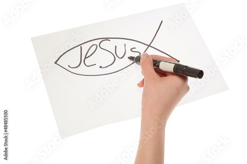 Hand girl drawing a Christian fish symbol
