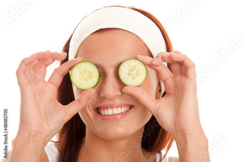 Woman with slices of cucumber