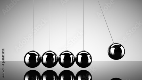 Balancing balls newtons cradle over dark background
