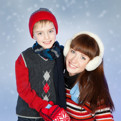 Happy mother and son in winter clothes