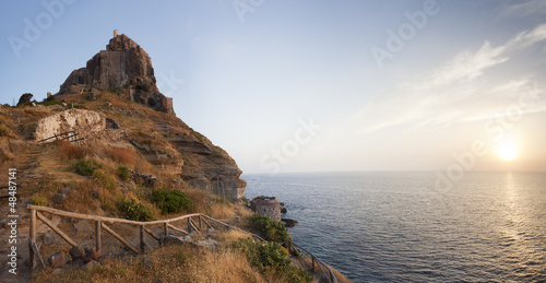 panorama of castle on Capraia island with rising sun, Elba