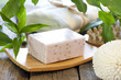 Spa soap with towel on wooden boards