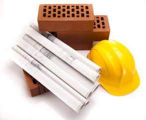 Construction plans and blueprints, bricks