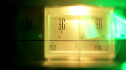 a glowing radio with the marker running through stations