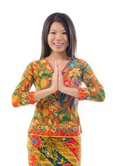 Southeast Asian female greeting