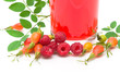 rose hips, raspberries and fruit tea on a white background