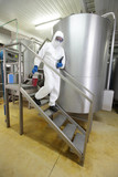 professional  walking down the stairs  in lab plant