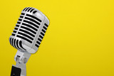Fototapety Vintage microphone isolated on yellow