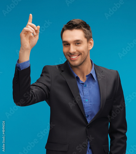 man in suit with his finger up