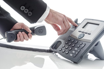 Male hand hanging up phone