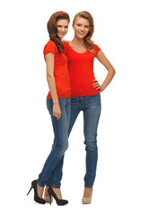 two beautiful teenage girls in red t-shirts