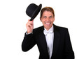 Man in tuxedo with hat celebrating