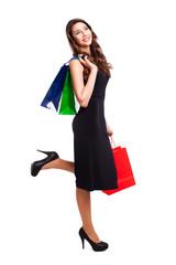 attraktive brünette junge Frau mit Einkaufstaschen