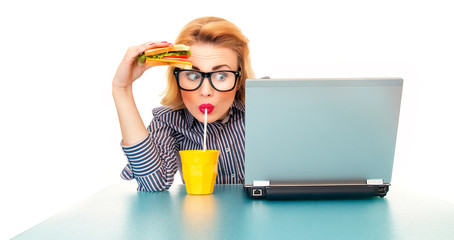 Funny business woman holding sandwich and drinking juice