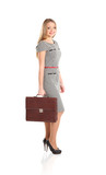 portrait of young business woman holding briefcase in hand