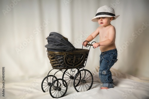 Portrait of a boy with a stroller in the studio