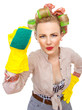 Funny young housewife with gloves holding scrubber, isolated