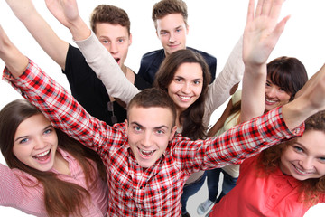 Excited group of people with arms up isolated over a white